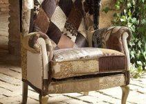 Sillón clásico tapizado en tela orejero